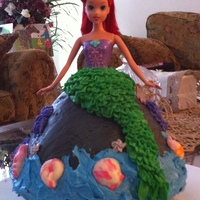 Ariel Cake Made for my friend's five years' old daughter. Made with the Wilton Wonder mould. Sea shells made with chocolate moulds....