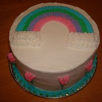 Wilton Course 1   Final cake for course 1rainbow transfer, sweet peas and a shell border with dots