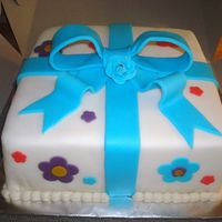 First Fondant Cake  Wilton course 3 second cake, it was also my first fondant cake.I found the corners very hard, the rest was pretty easyWASC cake with...