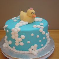 Rubber Ducky Bubble Bath Chocolate WASC cake with vanilla pudding filling. MFF with buttercream bubbles.The duck was modelled with fondant/gumpaste mix with added...