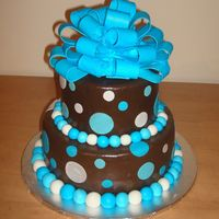 Wilton Course 3 Final  This is my final cake for wilton course 3, though there is nothing wilton about this, lol!Chocolate MMF with MMF accents. (ok the loopy bow...