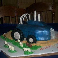 Pulling Tractor  This cake is for a charming little boy hitting the terrible two's. It is suppose to be a pulling tractor like the one the boy's...