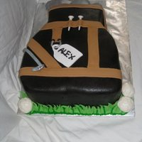 Golf Bag I got this design idea from TheCakeDude. I carved this cake into the shape of a bag. The cake is vanilla WASC with butter cream filling....