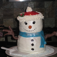 Snowman Cake Carved snowman cake. The bottom cake is an 8inch chocolate round, and the top is a 6inch vanilla round cake. Both filled with butter cream...
