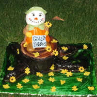 Tree Stump W Scare Crow I tried to replicate one of the cakes I saw in an album for the Oklahoma Sugar Show. I made this for my family on Thanksgiving. The tree...