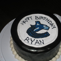 Canucks Puck Small 8inch round chocolate and vanilla cake. Covered in MMF and airbrushed black, the Canucks logo is a royal icing picture (my first time...