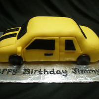 Bubblebee Birthday Cake A car shaped white cake with lemon frosting covered and decorated with fondant.