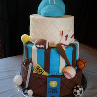 Sports Theme Baby Shower Cake Three tier yellow butter cake with strawberry, vanilla, and chocolate frosting.