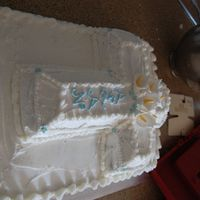 Baptism Cake  I made this cake for my son`s batism. Vanilla bottom with strawberry buttercream filling along with fresh sliced strawberries. Cross was a...