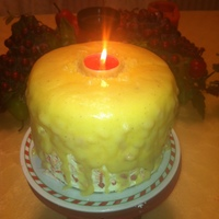 Christmas Candle Cake   Cakes is white with eggnog filling and peppermint frosting...with peppermint candies...