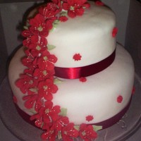 Red And White Wedding Engagement   I made this cake for a friend who's son was proposing on Christmas Eve. His girlfriend was so surprised! fondant with royal flowers