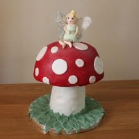 Toadstool Fairy Tinkerbell Cake All made out of vanilla cake with buttercream and strawberry filling. I didnt get the support system entirely right and had a bit of a...