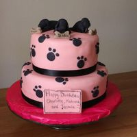 Dog Themed Pink And Black Cake Bottom tier is chocolate, with chocolate fudge filling. Top tier is vanilla with strawberry filling. Models make out of sugarpaste. I...