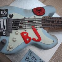 Green Day Guitar Cake A cake replica of Billie-Joe (from Green Day) guitar for a 21st Birthday girl! The real guitar picture is in the extra photos.