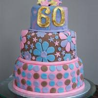 60's Themed Retro 60Th Birthday Cake Botom tier = vanilla sponge with buttercream and strawberry filling, second tier = chocolate fudge, top tier = tie-dyed vanilla sponge with...