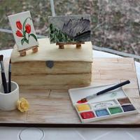Watercolour Painting Cake The box is ginger cake with orange buttercream filling. I handpainted the box and board (covered in fondant) with fool colouring diluted in...