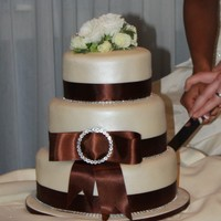 Ivory & Brown Diamante Wedding Cake Simple yet elegant and classy 3 tiered wedding cake (Sticky ginger cake with orange buttercream, Spiced carrot with vanilla and cinnamon...