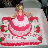 First Barbie Cake! yellow cake with buttercream icing. Used slab pan for the base and a glass bowl for the dress lol