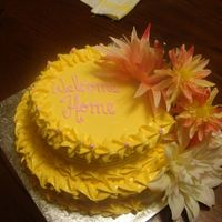 Cakes_003.jpg yellow cake, whipped vanilla icing, flowers in two flower spikes