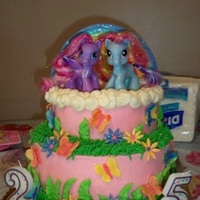 My Little Pony My Lil Pony cake for two sisters. Buttercream with fondant/gumpaste accents. The rainbow is colored gumpaste that I cut into strips and...