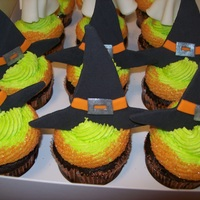 Witch's Hat Cupcakes Chocolate cupcakes with orange creamsicle filling and BC frosting with orange sanding sugar around the edges. Witches hats made of fondant...
