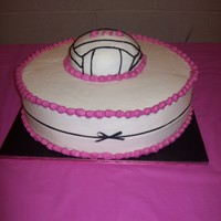 "Volleyball This is a 14"" half white, half chocolate cake with a half ball chocolate cake on top with Indydebi's BC and a gross grain ribbon..."