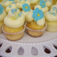 Blue Floral Mini Cupcakes These were on the dessert table at my sister's bridal shower. Mini lemon cupcakes with lemon curd filling and lemon IMBC. Royal icing...