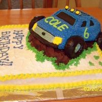 Cole's 6Th Birthday Monster Truck Cake Flat Sheet cake, white cake with strawberry truck, used wilton volkswagon cake and all buttercream frosting.