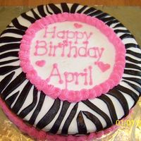 Zebra Cake With Hot Pink Round Lemon Cake, Butter cream Icing, With Hot Pink Buttercream Icing for piping and words, and black Fondant cut out to form zebra pattern...
