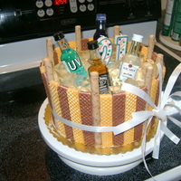 21St Booze Barrel WASC with cookies and cream filling and buttercream. Barrel is wafer and pirouette cookies. Ice is unflavored gelatin made with 7-up and...