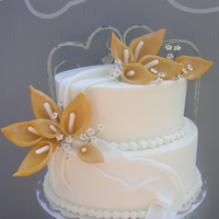 Anniversary Cake 50th wedding anniversary cake.. fondant flowers & swag, frosted in bc