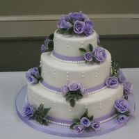 Lilac Roses Wedding Cake My first wedding cake! Lilac gumpaste roses (they show blue in the pic), fondant, vainilla cake with strawberry buttercream. It is not my...