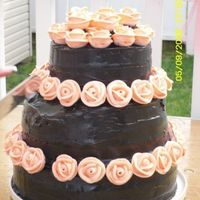 Black & Peach Wedding Cake This was my first black wedding cake. The cake was white chocolate with raspberry filling, chocolate buttercream covering cake topped with...