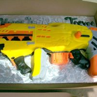 Nerf Cake My hairdresser wanted a nerf gun cake for her son, his fav is the long shot but they only needed 10-15 servings so I modified the gun to be...