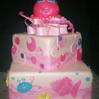 Octopus Cake This was for a baby shower, it was based on the nursery bedding