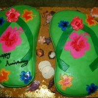 Flip Flops the sea shells were white chocolate and the flowers were fondant, the sand was gram crakers.