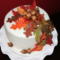 Fall Thanksgiving Cake This is a 4 layer chocolate cake with a coffee infused pastry cream filling (supper yummy). A ganache frosting is under the ivory fondant....