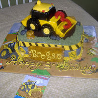 Tractor Cake Just finished, marble cake with buttercream filling, covered with buttercream, rice krispie treat tractor covered with fondant and fondant...