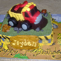 Dumptruck Cake Cake like my last one but this one has a dumptruck on top instead of tractor, marble cake with buttercream filling, truck is made of rice...