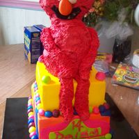Elmo Birthday Cake This is the second version of this cake I have made. Elmo's head is chocolate rkt, his body is peanut butter cake with peanut butter...