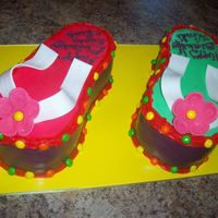 Flip-Flop Cake Flip-flop cake, right foot wasc with strawberry cream filling. Left foot was chocolate mud with strawberry cream filling both iced in bc...