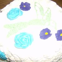 Humming Bird Pic  I did this cake in my final class in Wilton Course Two decoration. I had a rose mess up and the cake shape, also had to recover it with...