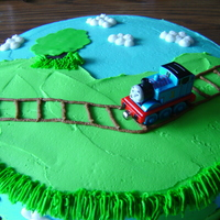Thomas The Train  BC frosting with fondant accents. Had fun doing this got the idea from pish on this site but client didn't want to pay for fondant so...