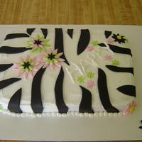 Zebra And Flowers  wht cake with coconut bc icing, fondant accents. Was in my head and needed to get out. My 4 yr old helped place the small star/flowers. TFL...