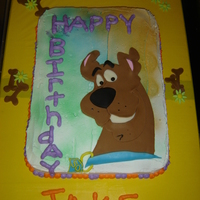 Scooby  1/2 sheet first attempt with sprey painting a cake. The writing is terrible but the kids loved it. Mext time I use fondant for lettering...