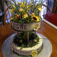 Wild Flowers This was my first Gumpaste Flower cake. I had a wonderful time making the flowers and making it look like a wild flower field. This was for...