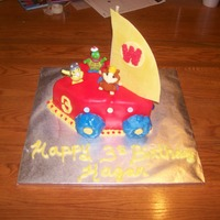 Wonder Pets Flyboat White candy/white chocolate cake with MMF. Flag is gumpaste, lights on sides are candy, wheels are MMF covered Marshmallow cookies. This...
