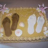 Jamaica Memories Honeymoon Shower Cake This is a carrot cake with cream cheese buttercream. Flowers and flip flops are gumpaste, seashells are chocolate. This cake smelled divine...