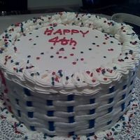 July_Cake.jpg Made this cake for the 4th of july. It's a white cake with fudge filling. I wanted to practice my basket weave. Cake is BC and the...