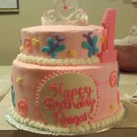 Birthday Princess First official cake order. Designed to match party invitations and decor for 1st Birthday Princess. Bottom tier Triple chocolate cake with...